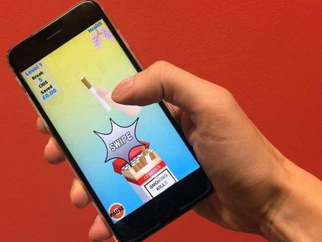 اس ایپ میں ایک گیم ہے جس کے دوران کھیلنے والے کو کم سے کم وقت میں زیادہ سے زیادہ سگریٹیں توڑنی ہوتی ہیں۔ (فوٹو: فائل)