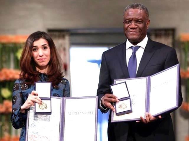 ڈاکٹر ڈینس مک ویگے اور نادیہ مراد 2018 کے نوبیل انعام برائے امن کے ساتھ ۔ فوٹو: رائٹرز