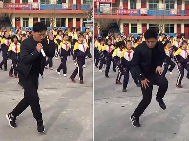 چین میں اسکول پرنسپل نے سینکڑوں بچوں کے ساتھ قدم سے قدم ملاکر ورزشی ڈانس کیا جس کی ویڈیو لاکھوں لوگ دیکھ چکے ہیں۔ فوٹو: ویڈیو شاٹ