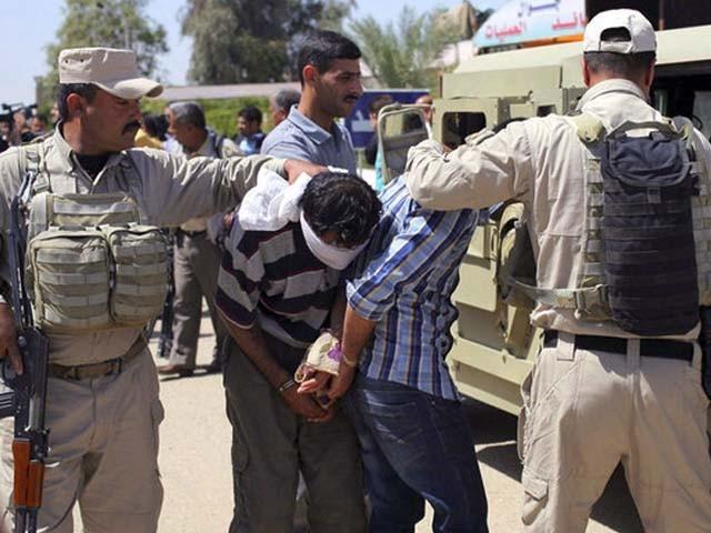 جنگجوؤں کو شام سے گرفتار کر کے عراق کے حوالے کیا گیا تھا۔ فوٹو : فائل