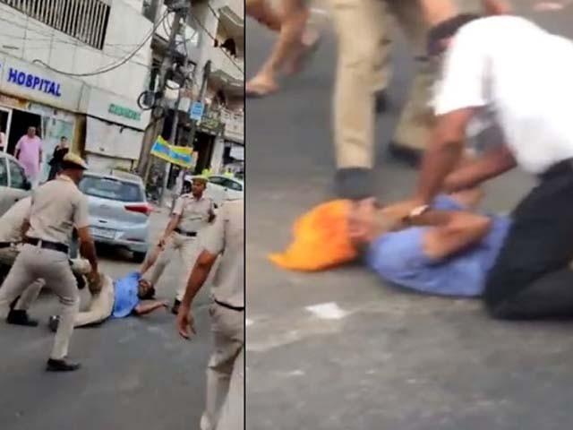 پولیس اہلکاروں نے سکھ ڈرائیور پر ہفتہ وار بھتہ نہ دینے کی پاداش میں تشدد کیا۔ فوٹو : ویڈیو گریب