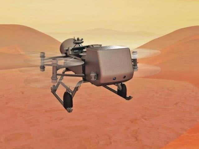 ڈریگن فلائی کی ایک خیالی تصویر، یہ مشن 2026ء میں روانہ ہوگا اور 2036ء میں زحل کے چاند ٹائٹن پر اترے گا (فوٹو: بشکریہ ناسا)