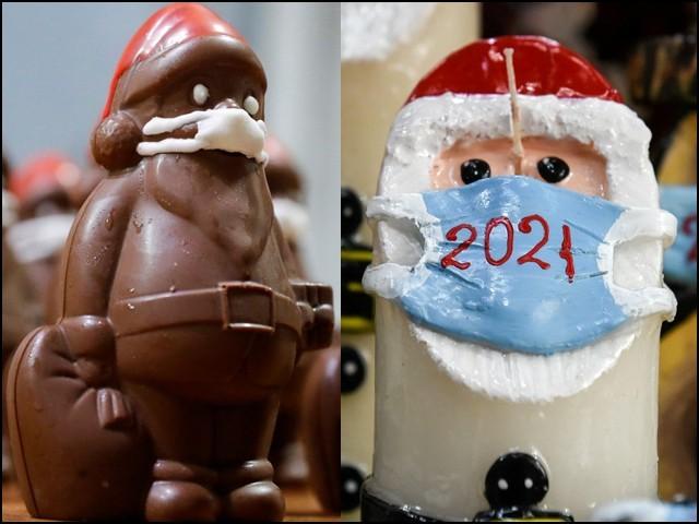 ماسک پہنے سانتاکلاز جیسی موم بتیوں اور چاکلیٹوں کو لوگ بہت پسند کررہے ہیں۔ (تصاویر: رائٹرز)