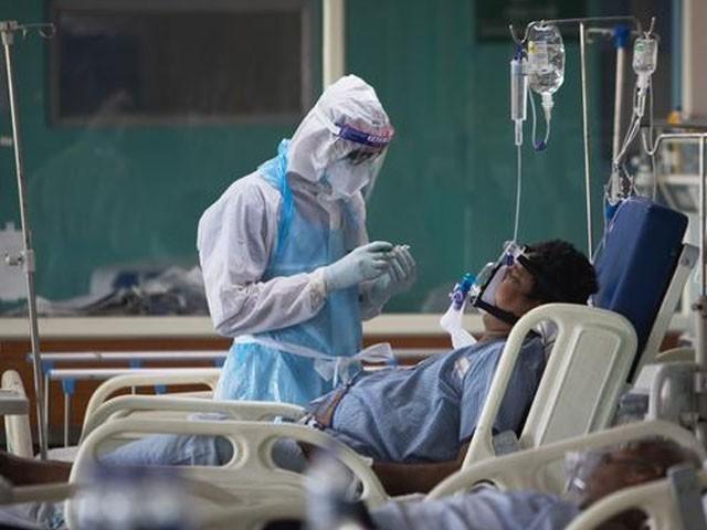 بھارت میں ویکسینیشن کے پہلے روز 2 لاکھ افراد کو کورونا ویکسین کا پہلا ٹیکہ لگایا گیا ، فوٹو: اے ایف پی