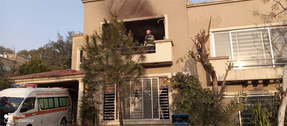 Home fire in Rawalpindi father mother and child found dead 2