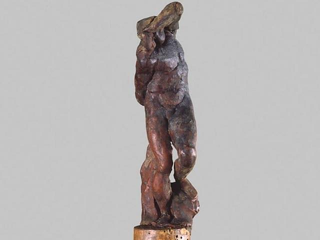 مائیکل اینجلو کی جانب سے تیارکردہ مومی مجسمہ 'غلام' جس کے ایک گوشے پر اس کے انگوٹھے کا نشان پایا گیا ہے۔ فوٹو: سی این این