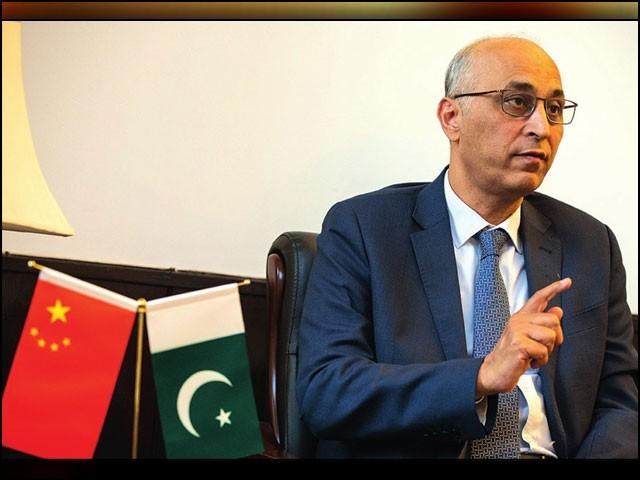 'افغان مسئلہ سیاسی عمل سے حل ہونا چاہیے، ایک ایسا سیاسی تصفیہ ہونا چاہیے جو افغان عوام کی خواہشات کے مطابق ہو،' معین الحق۔ (فوٹو: چائنا ڈیلی)