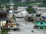 بارشوں کے باعث سیلابی ریلے میں کئی دیہات بہہ گئے، فوٹو: فائل